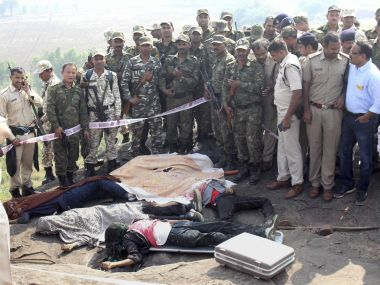 Police at the encounter site at the hillocks of Acharpura village after the STF killed 8 SIMI activists. PTI