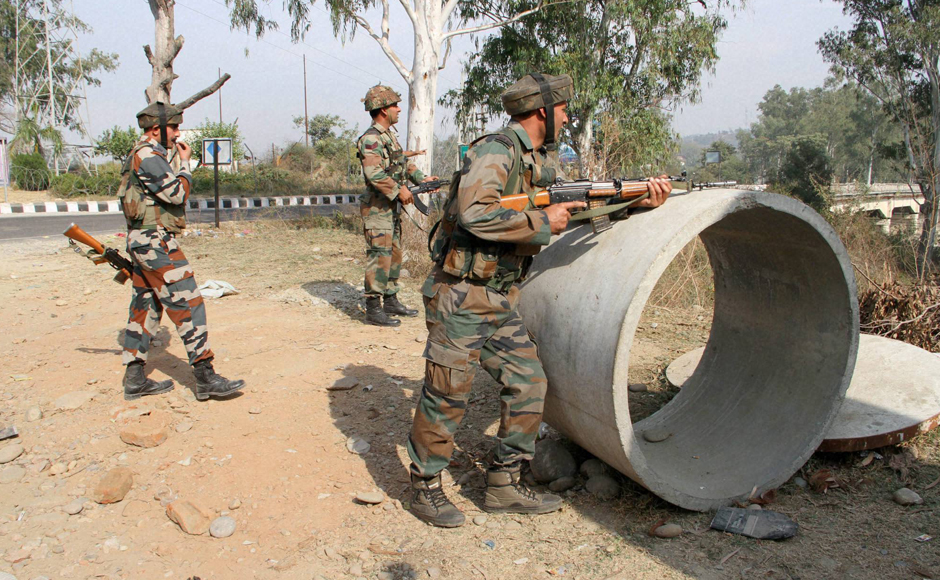 The number of casualties in the Nagrota Army Headquarter attack has risen to seven as two officers and five jawans lost their lives. Security personnel take positions during a gun battle with suspected militants near Jammu on Tuesday. (Photo: PTI)
