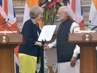 PM Narendra Modi and UK PM Theresa May. PTI