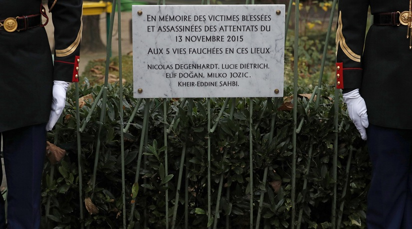 """A commemorative plaque unveiled by French President Francois Hollande and Paris Mayor Anne Hidalgo is seen next to the """"A La Bonne Biere"""" cafe and the Rue de la Fontaine au Roi street, in Paris, France, Sunday, Nov. 13, 2016, during a ceremony held for the victims of last year's Paris attacks which targeted the Bataclan concert hall as well as a series of bars and killed 130 people. The plaque reads : In memory of the wounded and assassinated victims of the Nov. 13, 2015 attacks. (Philippe Wojazer/Pool Photo via AP)"""