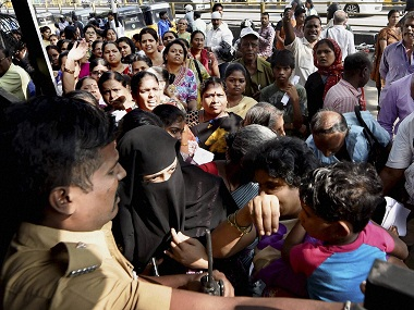 People scuffle to exchange Rs 1,000 and 500 notes at a bank in Chennai on Friday. PTI