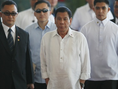 "Philippine President Rodrigo Duterte, center, is escorted to the podium for a news conference prior to boarding his flight for a three-day official visit to Japan at the Ninoy Aquino International Airport in suburban Pasay city, south of Manila, Philippines, Tuesday, Oct. 25, 2016. Duterte lashed out anew at the United States following Monday's interview with U.S. Assistant Secretary of State for East Asian and Pacific Affairs Daniel Russel who said that the Philippine president's controversial remarks and a ""real climate of uncertainty"" about the government's intentions have sparked consternation in the U.S. and other governments and in the corporate world. (AP Photo/Bullit Marquez)"