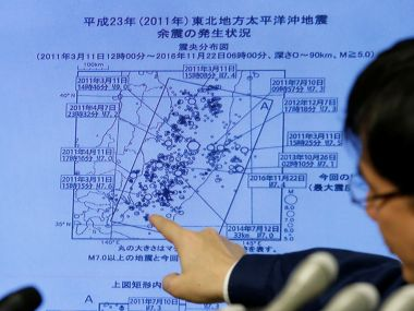 Japan Meteorological Agency's earthquake and volcano observations division director Koji Nakamura points at a map showing earthquake information during a news conference. Reuters
