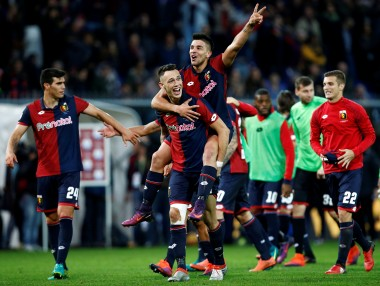 Genoa's Lucas Ocampos and Giovanni Simeone celebrate their win over Juventus. Reuters