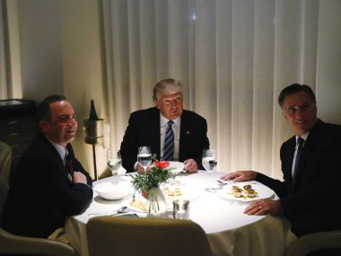 US President-elect Donald Trump with Mitt Romney and Reince Priebus. Reuters