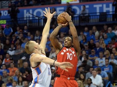 Toronto Raptors guard DeMar DeRozan shoots the ball over Oklahoma City Thunder forward Kyle Singler. Reuters