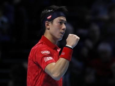 Kei Nishikori celebrates after winning his round robin match against Stanislas Wawrinka. Reuters
