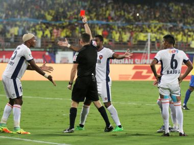 Referee shows a red card to FC Goa's Gregory Arnolin. ISL