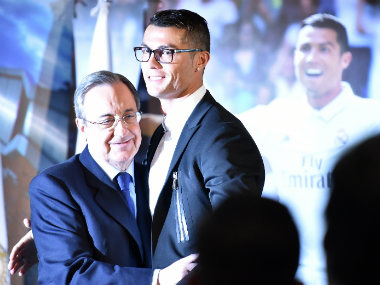 Ronaldo (R) and Florentino Perez (L) at the ceremony. AFP