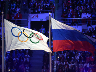 The Russian and Olympic flags at the closing ceremony of the 2014 Winter Olympics. AFP