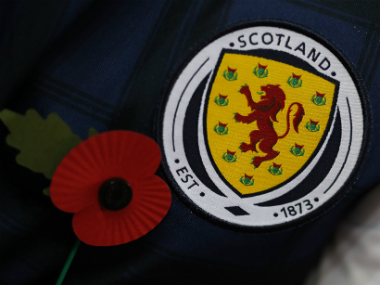 A Scotland supporter wearing the poppy symbol. AFP