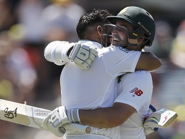 South Africa's JP Duminy (left) celebrates his century with Dean Elgar. AP