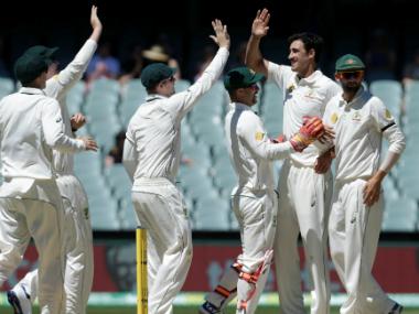 The Australian players celebrate a wicket. AP