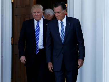 US President-elect Donald Trump (L) and former Massachusetts Governor Mitt Romney (R) emerge after their meeting at the main clubhouse at Trump National Golf Club in Bedminster. Reuters