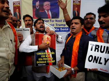 Members of Hindu Sena, a right-wing Hindu group, symbolically celebrate the victory of US Republican presidential nominee Donald Trump in the upcoming US elections, in New Delhi. Reuters