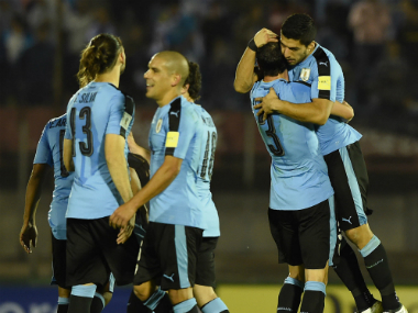 Uruguay convincingly beat Ecuador to stay hot on Brazil's heels. AFP