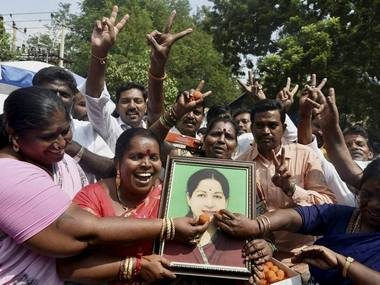 AIADMK cadres celebrating for their party's victory of three Assembly bypolls. PTI