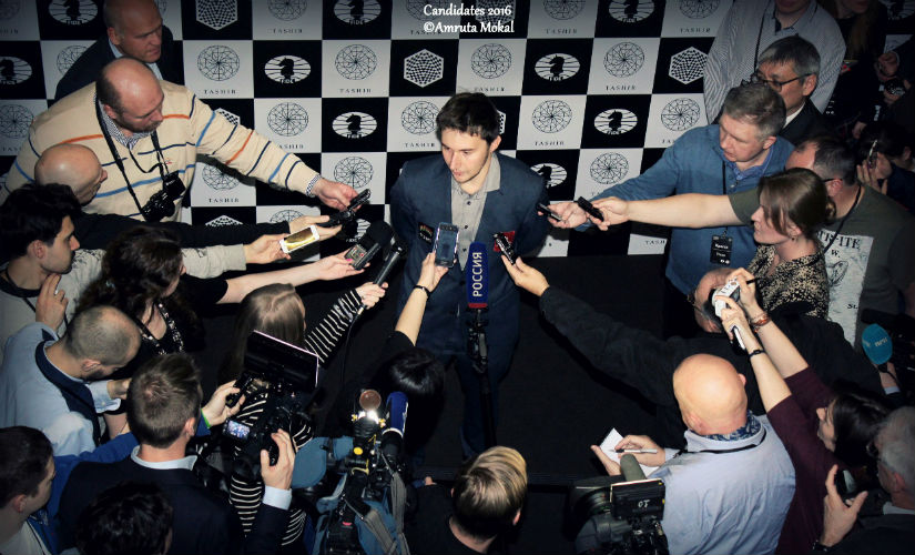Journalists swarm all over Sergey Karjakin, after he won the Candidates tournament in Moscow 2016. Image courtesy: Amruta Mokal.