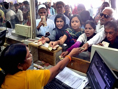 Allahabad: Passengers gives 500 rupees for train ticket at a booking window at Alalhabad Railway station in Allahabad on Wednesday. PTI Photo(PTI11_9_2016_000066B)