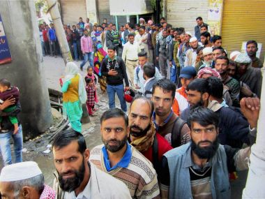 People queue outside the State Bank of India in Jammu and Kashmir. PTI