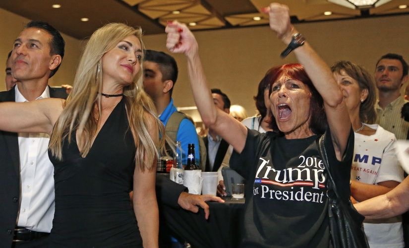 Supporters of Donald Trump during a pre-election campaign. AP