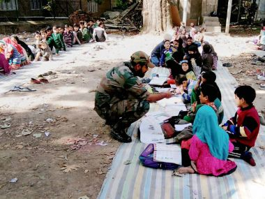 A jawan providing free coaching to students during operation 'School Chalo'  by Army at Awantipora in South Kashmir. PTI