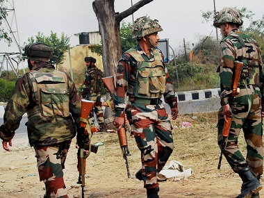 Army personnel take position during encounter after militants attacked an Army camp in Nagrota on the outskirts of Jammu on Tuesday morning. PTI