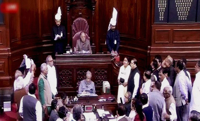 MPs protest in Rajya Sabha on Tuesday. PTI