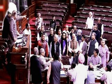 Deputy Chairman PJ Kurien trying to pacify the members holding a protest in the Well of Rajya Sabha in New Delhi on Thursday. PTI