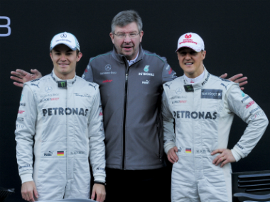 File image of Ross Brawn (C) and Michael Schumacher (R). AFP