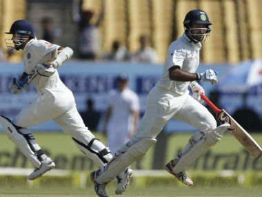 Pujara runs between the wicket with Vijay on the third day of the first Test between India and England. AP