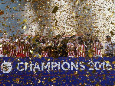 Atletico de Kolkata players celebrate with the ISL trophy. ISL