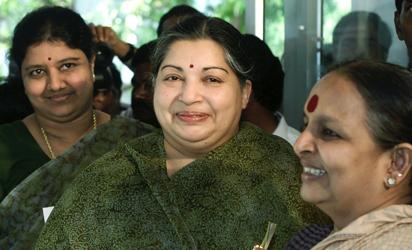 Former filmstar and powerful regional politician Jayaram Jayalalitha (C), leader of the opposition AIADMK party alliance, arrives with her companion Sasikala Natarajan (L) and an unidentified woman at a polling booth in Madras, May 10, 2001. Though polling for the state assembly was largely peaceful in the southern Indian state of Tamil Nadu, violence plagued elections in India's insurgency-hit state of Assam. SK/PB - RTRI1OI