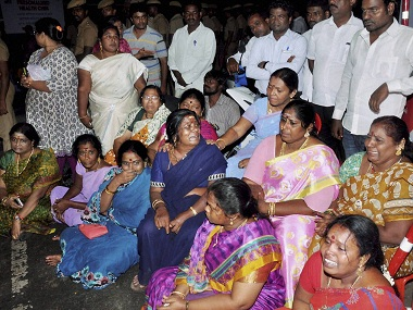 Chennai: AIADMK supporters sit in front of Apollo Hospital after Tamil Nadu Chief Minister, Jayalalithaa suffered a cardiac arrest in Chennai on Sunday. PTI Photo (PTI12_5_2016_000027B)