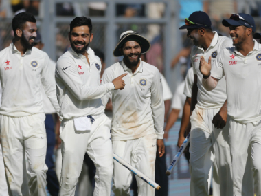 Virat Kohli and his team celebrate their 4th Test victory. AP