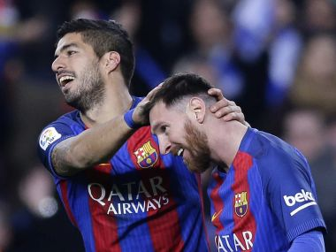 FC Barcelona's Luis Suarez celebrates with Lionel Messi after scoring. AP