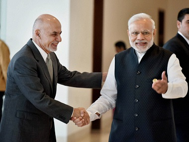 Prime Minister Narendra Modi and President of Afghanistan Ashraf Ghani shake hands at 6th Heart of Asia Conference in Amritsar on Sunday. PTI