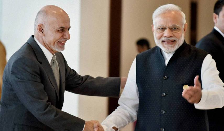 Amritsar: Prime Minister Narendra Modi and President of Afghanistan Ashraf Ghani shake hands at 6th Heart of Asia Conference in Amritsar on Sunday. PTI Photo  (PTI12_4_2016_000077B)