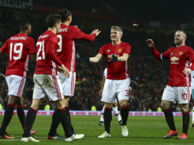 The Manchester United players celebrate after scoring their 4th against West Ham. AP