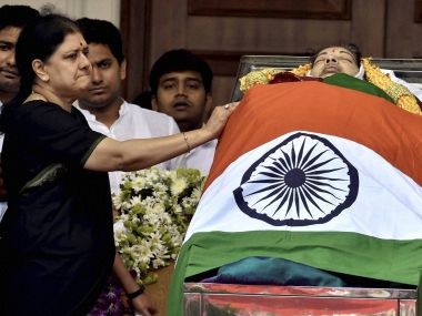 A file image of new AIADMK general secretary VK Sasikala with J Jayalalithaa's body. PTI