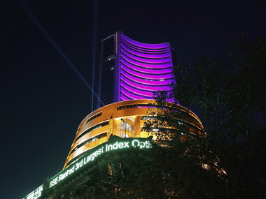 The Bombay Stock Exchange (BSE) building is illuminated during the Diwali special trading session celebrating the annual Hindu festival of lights in Mumbai November 3, 2013. India's benchmark BSE share index rose to a second consecutive record high in a special trading session on Sunday, led by gains in Indian Bank, Tata Motors and ONGC on expectations of better quarterly earnings, while strong foreign flows continued to boost sentiment. REUTERS/Danish Siddiqui (INDIA - Tags: BUSINESS RELIGION) - RTX14YO5
