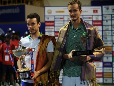 Roberto Buatista Agut holds the winning trophy after beating Daniil Medvedev in the Chennai Open final. AFP