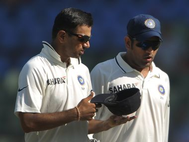 File photo of Rahul Dravid (L) and MS Dhoni. AFP