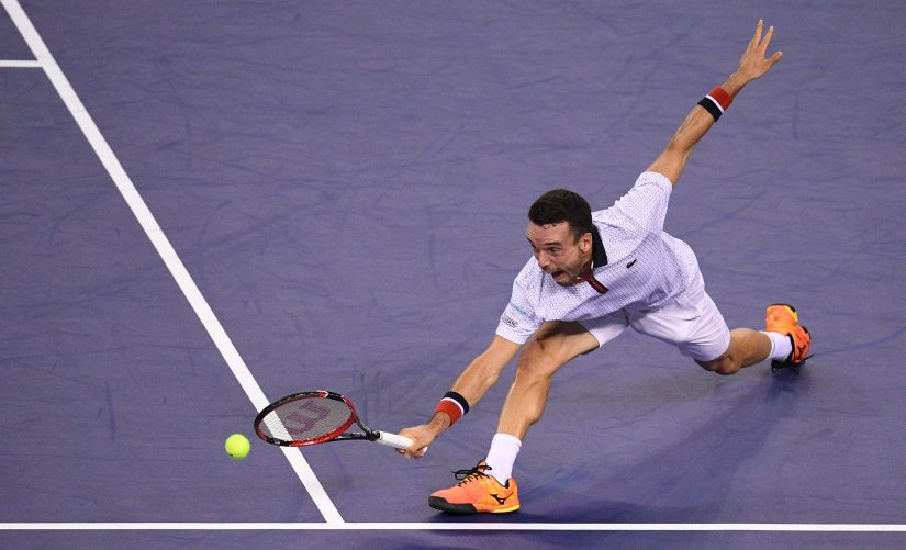 Roberto Bautista Agut hits a return against Novak Djokovic at the Shanghai Masters, a match that the Spaniard won. AFP