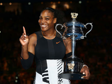 Serena Williams poses with the Daphne Akhurst Trophy after winning the Australian Open. Getty Images