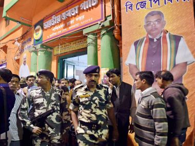 Security personnel in front of BJP state party office in Kolkata on Tuesday. PTI