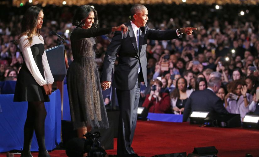 Barack Obama with wife Michelle and daughter Malia in Chicago. AP