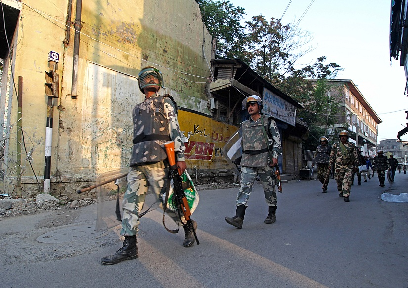 A patrolling party of the CRPF moves towards old town area of Srinagar, where AFSPA is in place, on a December morning. Photo courtesy Faisal Khan