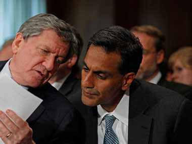 Richard Verma (R). AFP