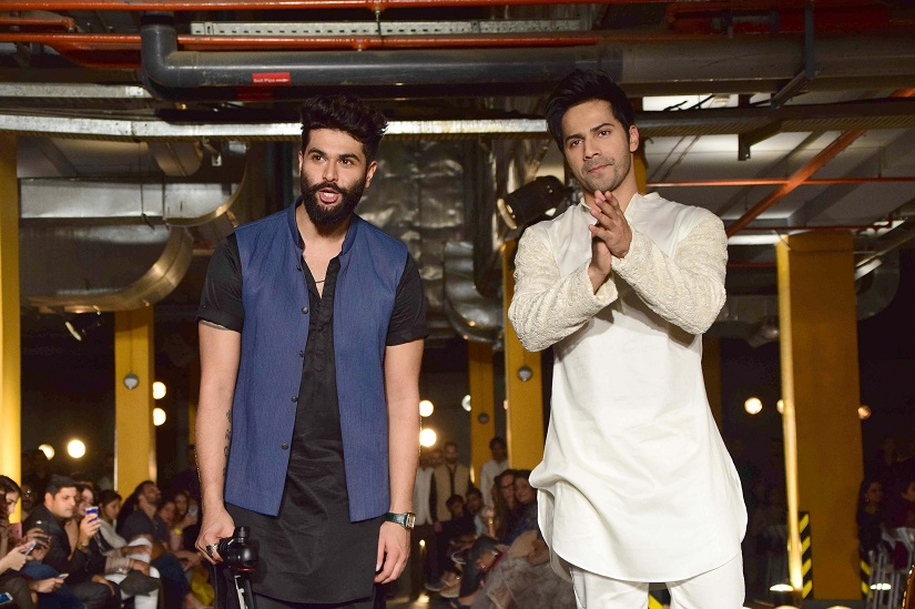 Fashion designer Kunal Rawal with Bollywood actor Varun Dhawan during his show at the Lakme Fashion Week Summer/Resort 2017, in Mumbai, India on February 1, 2017. (Sanket Shinde/SOLARIS IMAGES)